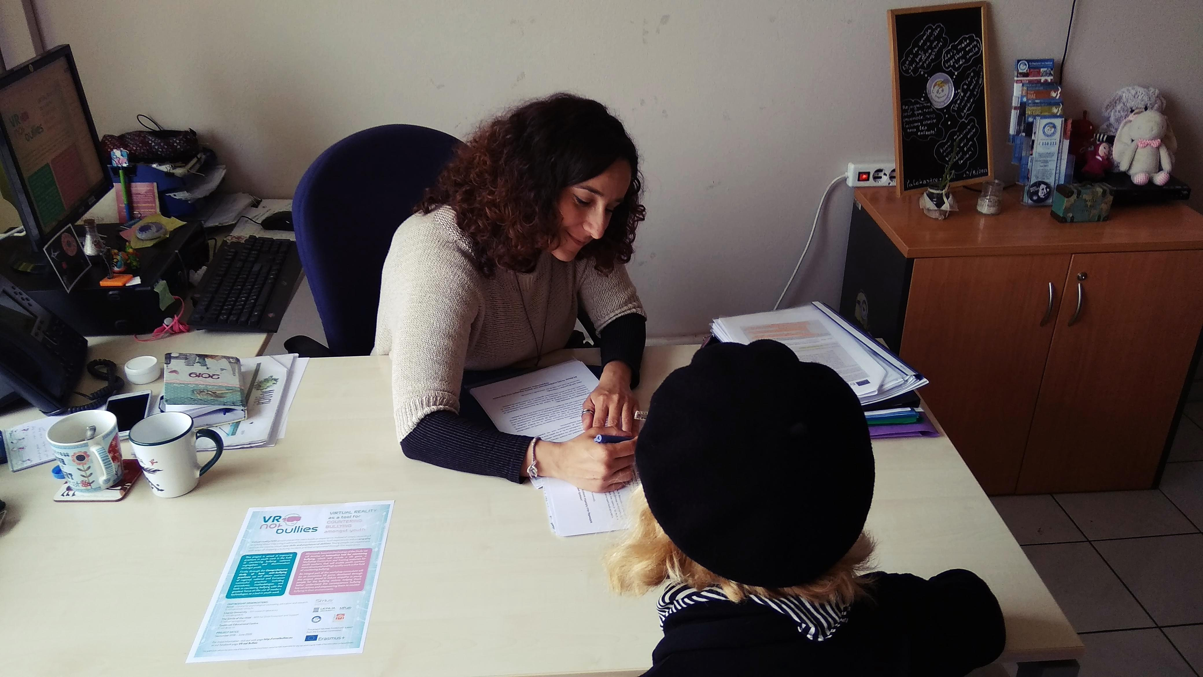 students filling out online questionnaire and Greek researcher Foteini Papadatou interviewing youth workers